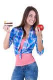 The girl picks an apple or a cake Stock Images