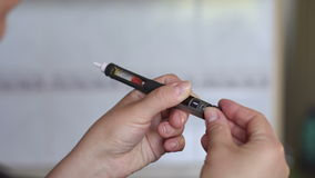 Girl picks up right dose of insulin on syringe pen. Close-up stock video footage