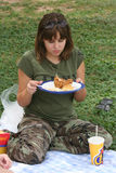 Girl on Picnic. Teenage girl eating fried chicken on a picnic Royalty Free Stock Image