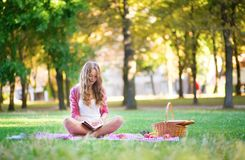 Girl on a picnic in park Stock Photo