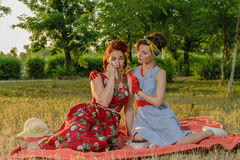 Girl on a picnic and sit gossiping. retro style Stock Photos