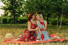 Girl on a picnic and sit gossiping. retro style Stock Images