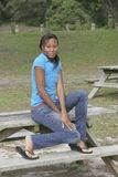 Girl on picnic table Stock Photos