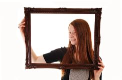 Girl with picture frame. Stock Images