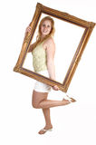 Girl with picture frame. Royalty Free Stock Photo