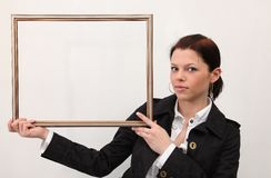 Girl with picture frame Royalty Free Stock Image