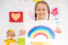 Girl with picture of rainbow Royalty Free Stock Photos