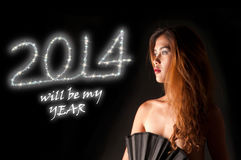 2014 Girl. Picture of a girl watching 2014 sparklers Stock Photo