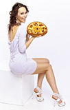 Girl with a pie. Pretty girl holding a pie in her hands Stock Photography