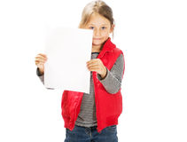 Girl with  piece of paper. Little cute girl holding a sheet of white paper Royalty Free Stock Photo