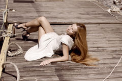 Girl on the pier. The image of a beautiful girl on the pier Stock Image