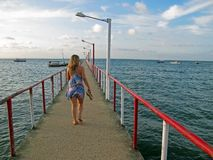 Girl in pier Royalty Free Stock Photos