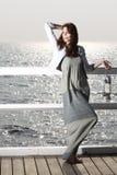 Girl on pier with kerosene lamp Royalty Free Stock Images