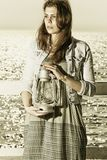 Girl on pier with kerosene lamp Royalty Free Stock Photos