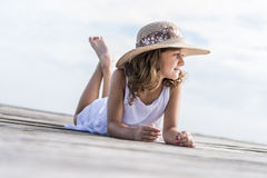 Girl on the pier. Girl lying on wooden pier Royalty Free Stock Photos