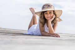 Girl on the pier. Girl lying on wooden pier Royalty Free Stock Photography