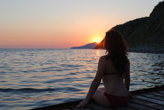 Girl on a pier on sunset Royalty Free Stock Photos