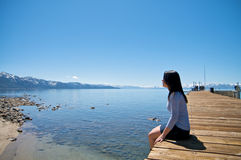 Girl at a pier at vacation resort Stock Photography