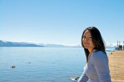 Girl at a pier at vacation resort Stock Photography