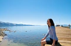 Girl at a pier at vacation resort Stock Photo