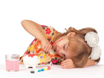 Girl with piggy bank Stock Photos