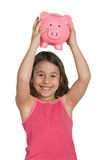Girl with piggy bank. Smiling happy little girl with piggy bank Stock Photo