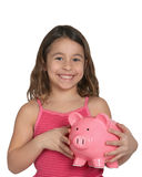 Girl with piggy bank. Cute little girl with piggy bank isolated on white Stock Photo