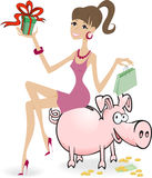 Girl on the piggy bank Royalty Free Stock Image