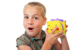 Girl piggy bank Stock Photography
