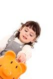 Girl and piggy bank Royalty Free Stock Photos