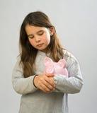 Girl piggy bank. Girl holding a piggy bank Stock Images