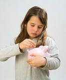 Girl piggy bank. Girl holding a piggy bank Royalty Free Stock Photos
