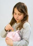 Girl piggy bank. Girl holding a piggy bank Stock Photos