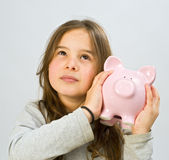 Girl piggy bank Stock Images