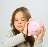 Girl piggy bank Stock Photo