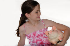 Girl with piggy bank Stock Photography