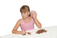 Girl with piggy bank isolated Stock Images