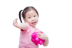 Girl with piggy bank over white Royalty Free Stock Image