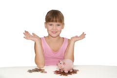 Girl with piggy bank showing copy space Royalty Free Stock Photos