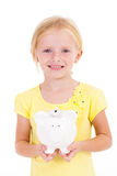 Girl with piggybank Stock Images