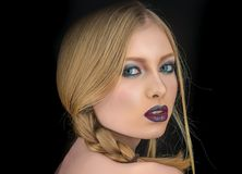 Girl with pigtail blond hair. girl with makeup on sexy face. Girl with pigtail blond hair. girl with makeup on sexy face Stock Photography