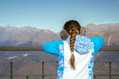 Girl with pigtail, mountain landscape, Krasnaya Polyana, Sochi royalty free stock photos