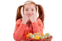 Girl with pigtails  and  basket of Easter eggs Royalty Free Stock Image