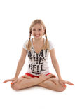 Girl with pigtails doing yoga Stock Photos