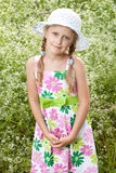 Girl with pigtails in the hat Stock Photo
