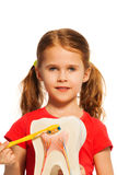 Girl with pigtails holding tooth model and brush Stock Image