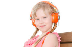 Girl with pigtails listening language lessons in headphones isol Stock Photography
