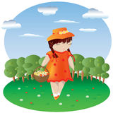 A girl with pigtails in an orange dress and a hat with a basket in a dotted with flowers, behind a forest and sky. A girl with pigtails in an orange dress and a Royalty Free Stock Images