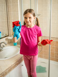 Girl with pigtails posing at bathroom while doing cleaning Stock Photos