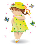 A girl with pigtails in a yellow dress and a hat with butterflies on her hat, a flower in her hand. Butterflies and petals fly nearby Royalty Free Stock Photography